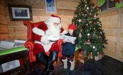 Children speak to Santa after being the first to board.