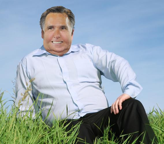 Photo illustration of Mitt Romney as an obese man.