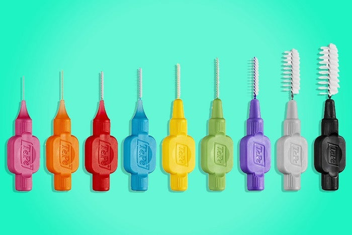 different colors and sizes of TePe interdental brushes