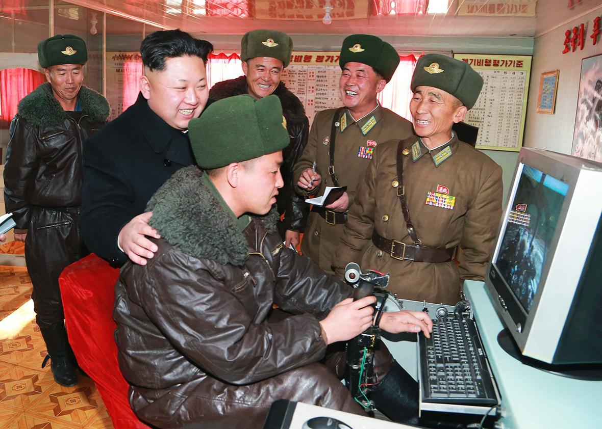 North Korean leader Kim Jong Un smiles as he inspects the KPA Air and Anti-Air Force Unit 99.