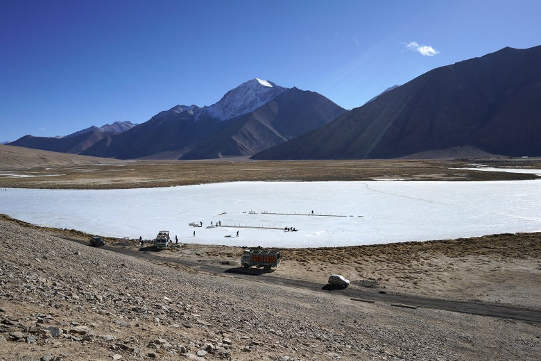A hockey rink being built on the frozen flood plain in Chibra Kargyam.