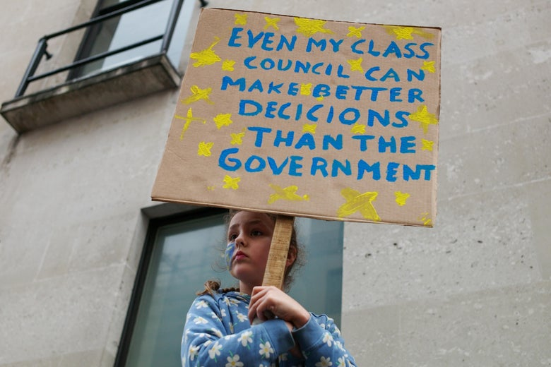 A youngster holds a sign as thousands of demonstrators take to the streets of London during the People's Vote March on March 23, 2019 in London, England.