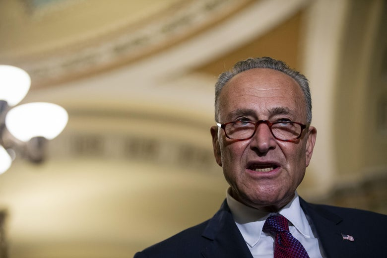 Senate Minority Leader Chuck Schumer (D-NY) speaks with fellow Senate Democrats during a news conference following the weekly Senate Democrats policy luncheon, on Capitol Hill, on July 10, 2018 in Washington, DC.