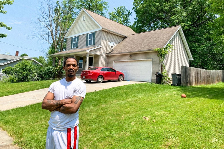 Tre Lewis stands in his front yard.