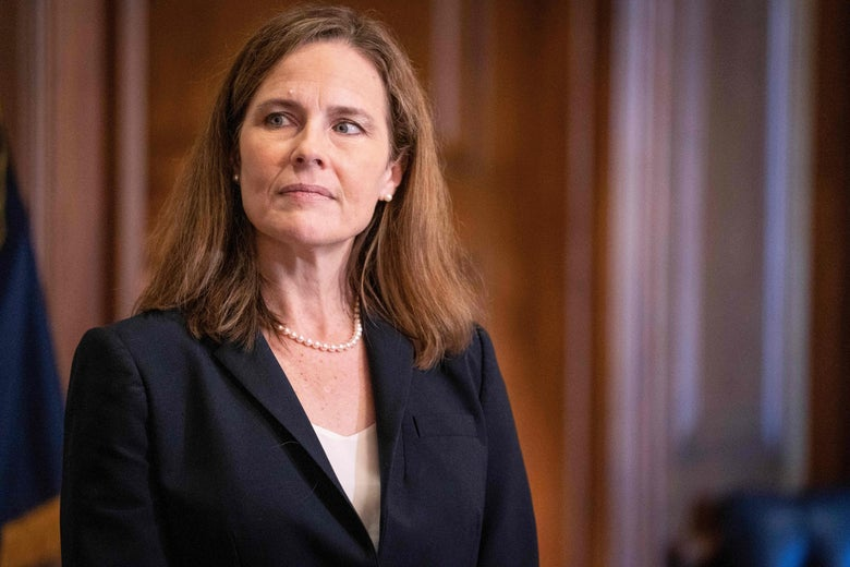 Judge Amy Coney Barrett standing, looking to her right
