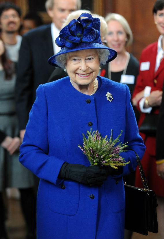 Queen Elizabeth II dressed in blue.