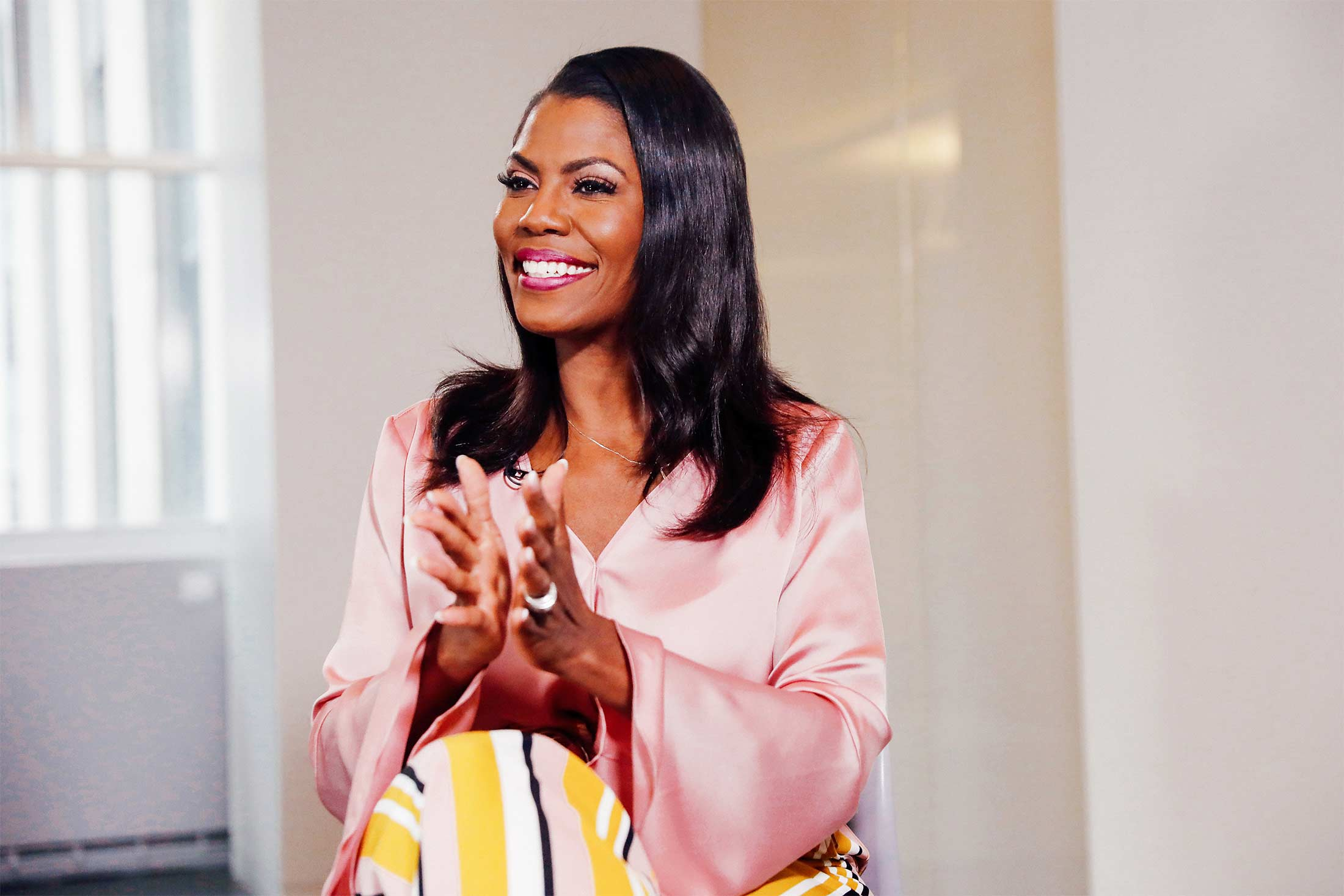 Omarosa Manigault-Newman claps during an interview on the release of her book, Unhinged, on Tuesday in New York City.