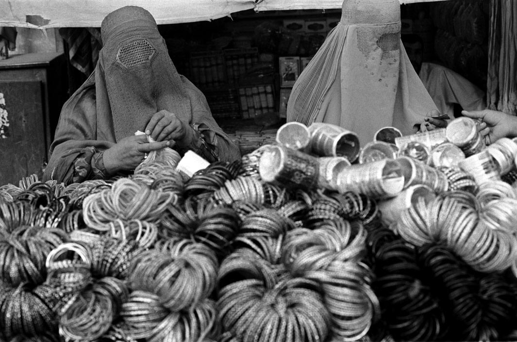 Women shopping for bangles at a bazaar in Kandahar. August 2004