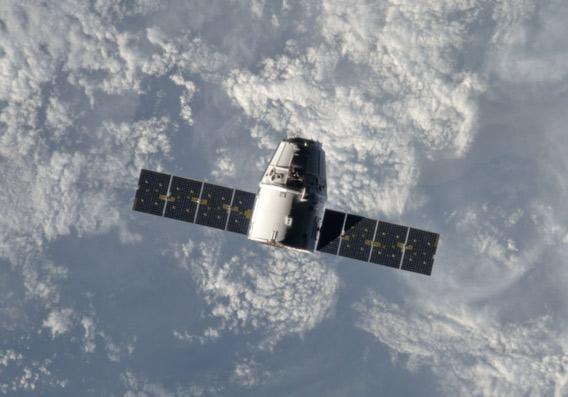 Dragon capsule in space in 2012