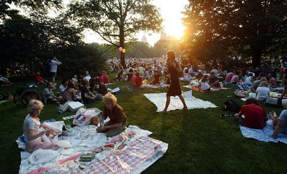 People gather before a free concert in Central Park by the New York Philharmonic
