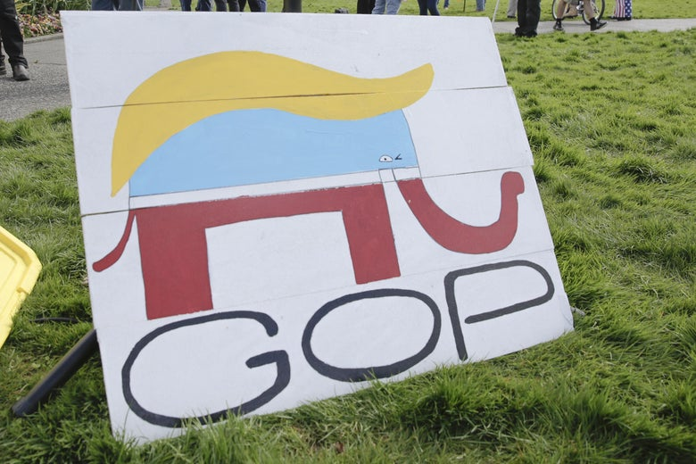 A Republican Party elephant logo is pictured with the hair of Donald Trump during a demonstration against Washington state's stay-home order at the state capitol in Olympia, Washington, on April 19, 2020.