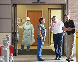 Health care workers wait for the arrival of a possible Ebola patient at the Texas Health Presbyterian Hospital on Oct. 8, 2014, in Dallas