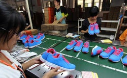Chinese workers making shoes at a factory