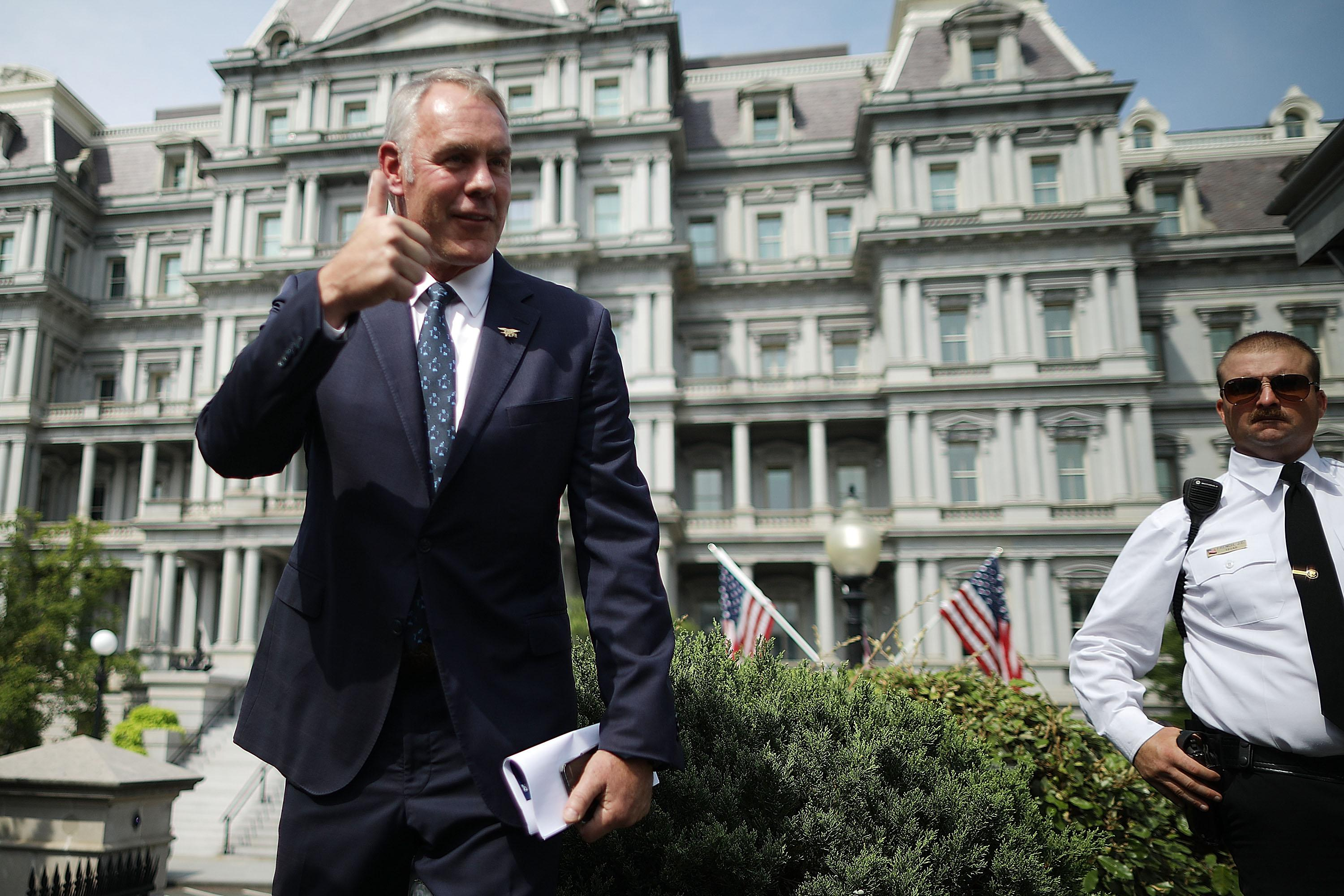 Ryan Zinke, the Interior Secretary, talking to reporters outside the White House