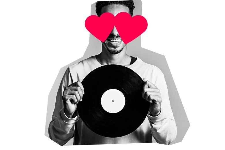 Smiling man holding a vinyl record with hearts over his eyes