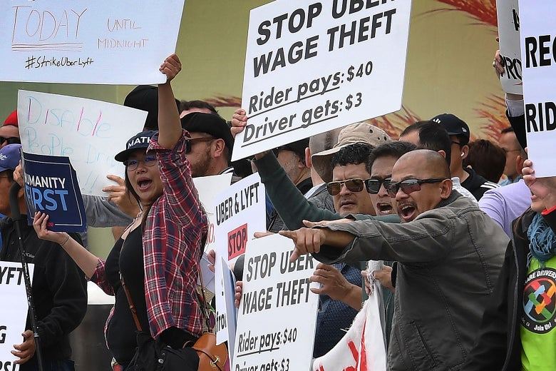 Drivers for Uber and Lyft stage a strike and protest at the LAX International Airport.