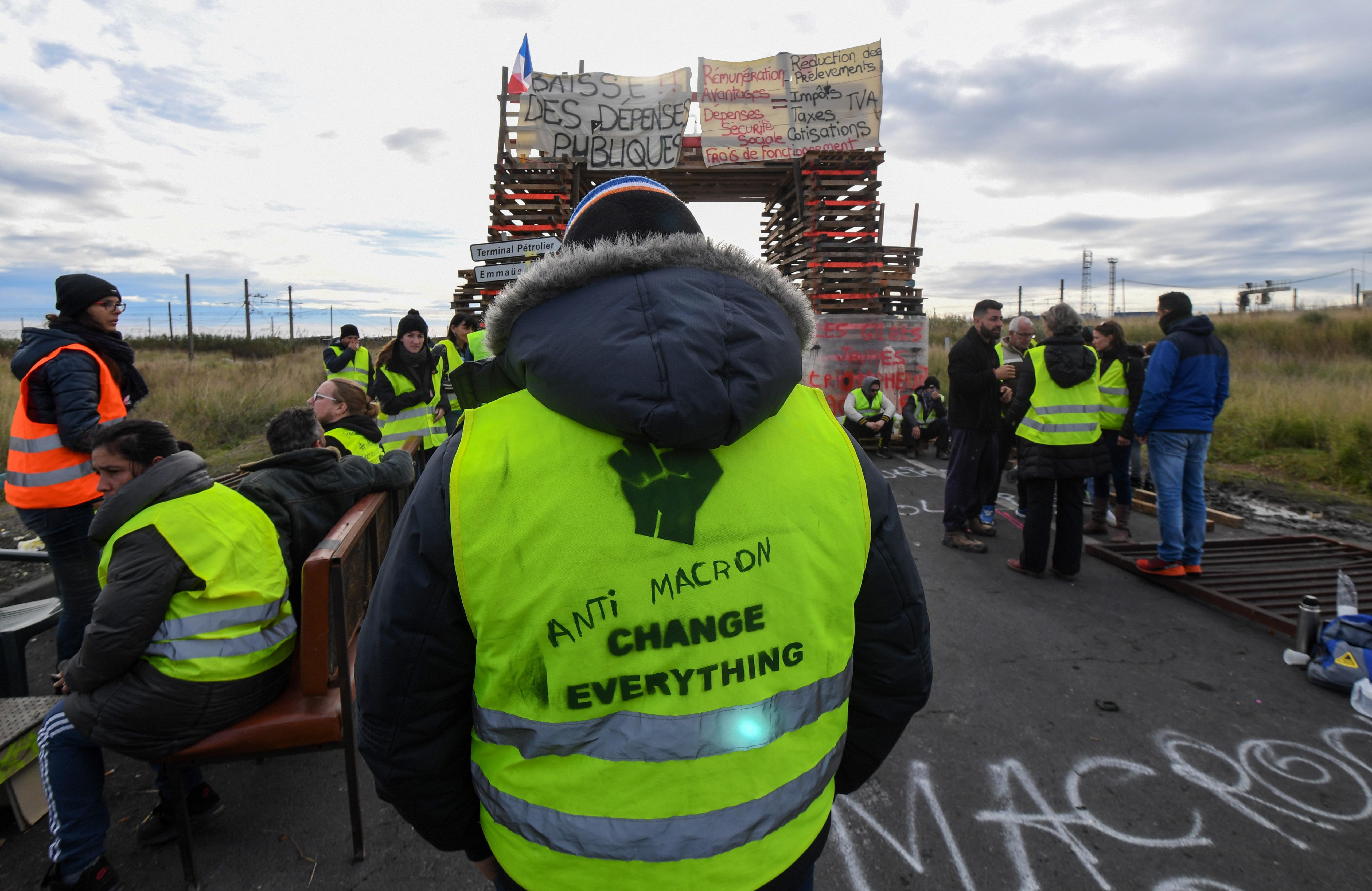 Yellow vests (Gilets jaunes) protesters block the road leading to the Frontignan oil depot in the south of France, as they demonstrate  against the rise in fuel prices and the cost of living on December 3, 2018. - Dozens of French 'yellow vest' demonstrators blocked access to a major fuel depot and several highways on the third week of anti-government protests which led to major riots in Paris at the weekend. (Photo by PASCAL GUYOT / AFP)        (Photo credit should read PASCAL GUYOT/AFP/Getty Images)