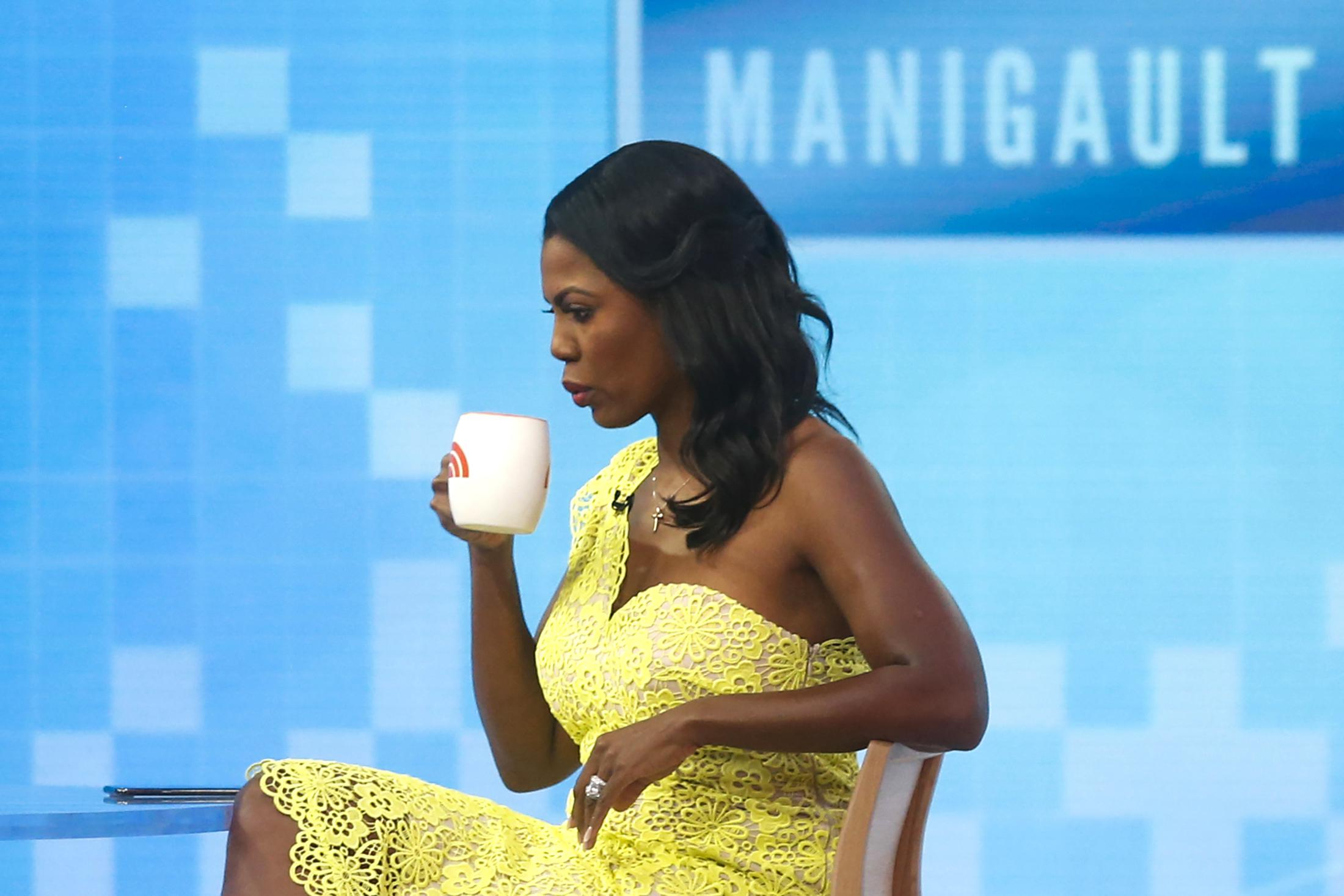 Omarosa drinks from a mug on the set of the Today show.