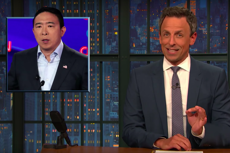 Seth Meyers behind the late show desk with Andrew Chang on the left.