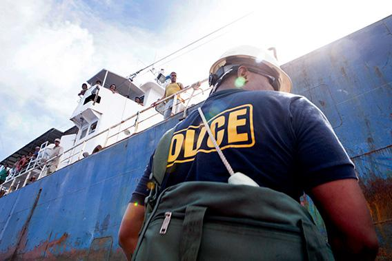 A week after encountering the tuna-laundering boats, officer Earl Benhart of Palau's Marine Police prepares to board the Sal 19, a fishing vessel transiting through Palauan waters.