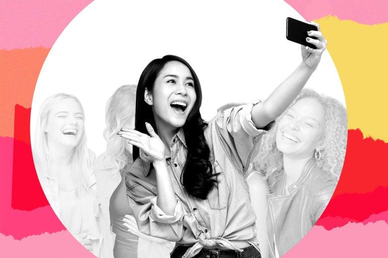 Twentysomething woman taking a selfie with friends.