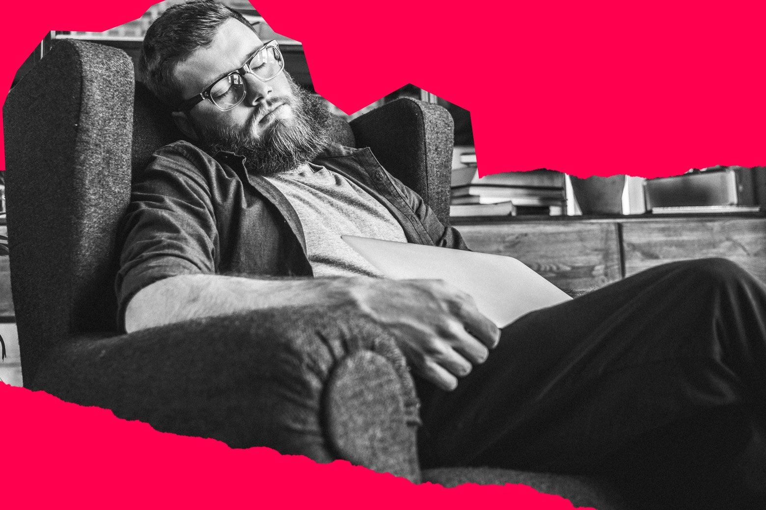 Man sleeping in armchair.