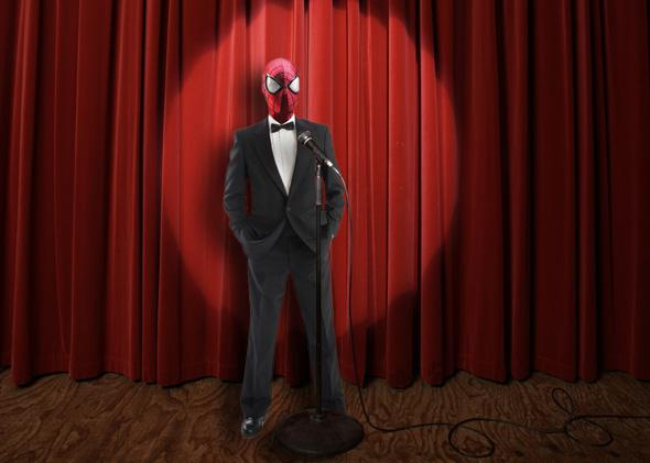 Spiderman on a stage in a tux
