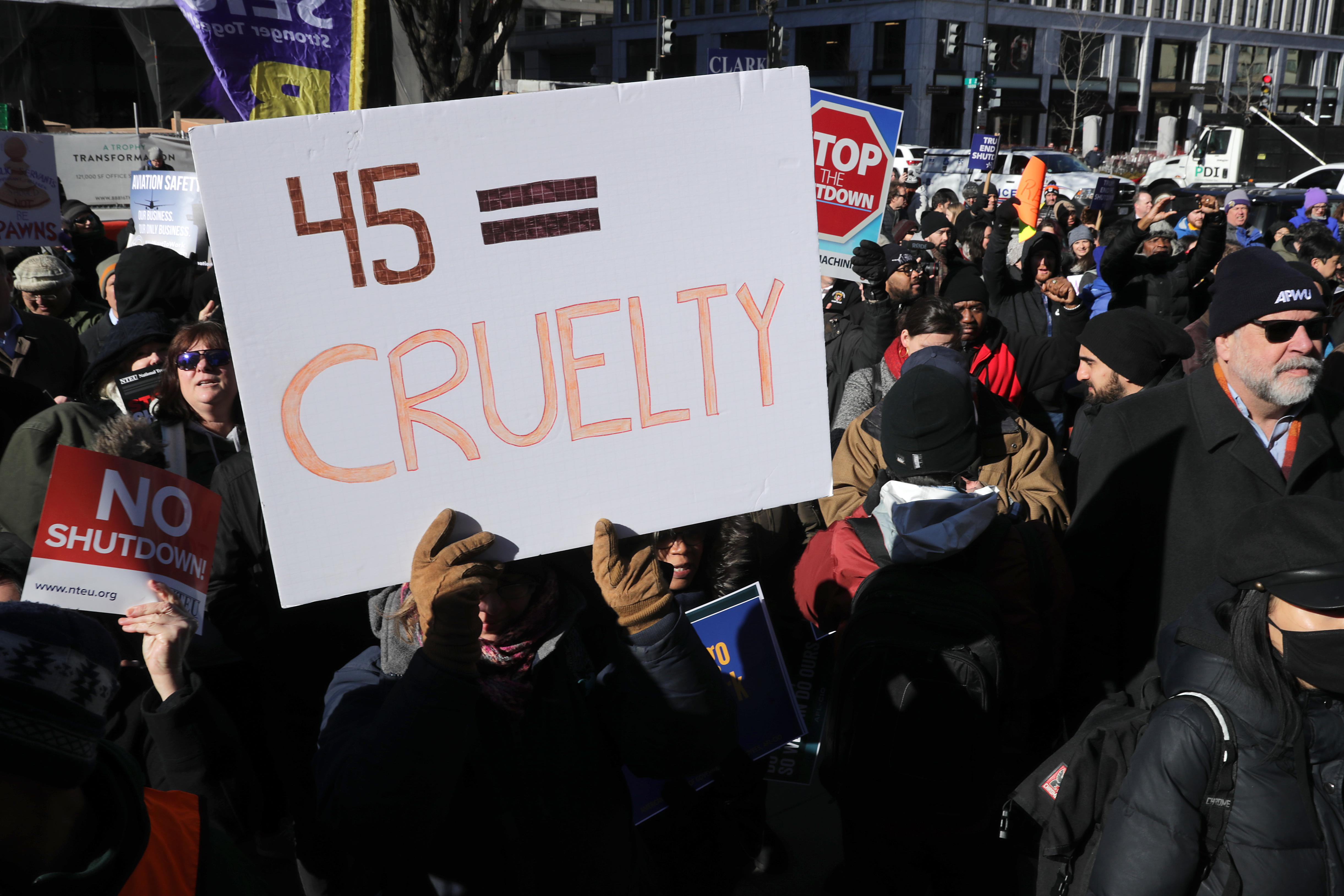 Federal workers and contractors rally against the partial federal government shutdown outside the headquarters of the AFL-CIO.