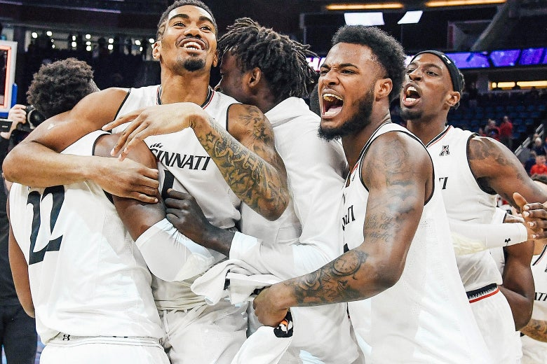The Cincinnati Bearcats celebrate their championship after the final game of the 2018 AAC Basketball Championship against the Houston Cougars at Amway Center on Sunday in Orlando, Florida.
