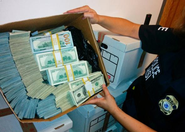 Money seized during a raid in Los Angeles, Sept. 10, 2014.