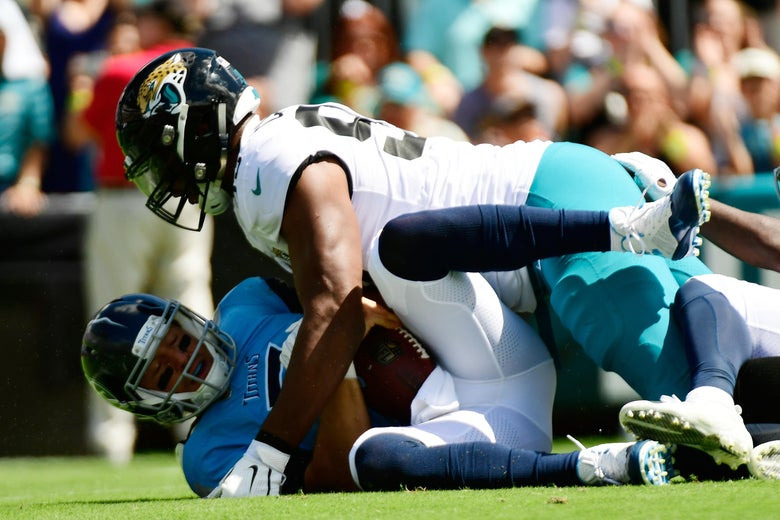 JACKSONVILLE, FL - SEPTEMBER 23:  Blaine Gabbert #7 of the Tennessee Titans is sacked by Calais Campbell #93 of the Jacksonville Jaguars during their game at TIAA Bank Field on September 23, 2018 in Jacksonville, Florida.  (Photo by Julio Aguilar/Getty Images)