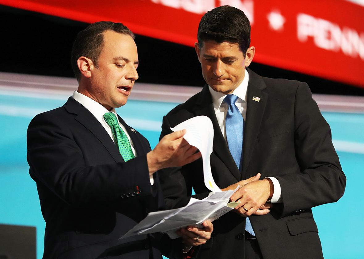 Reince Priebus, chairman of the Republican National Committee, and Speaker of the House Paul Ryan consult one another about the recount of Alaska delegation votes after roll call on the second day of the Republican National Convention on July 19, 2016 at the Quicken Loans Arena in Cleveland, Ohio.