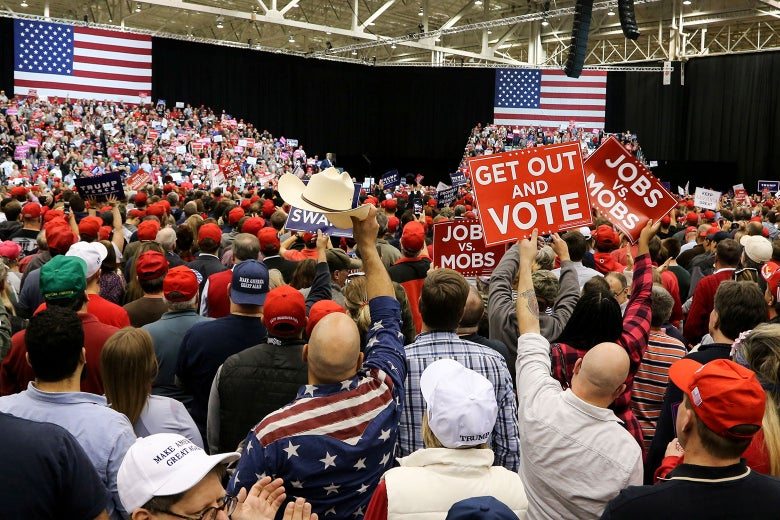 Supporters of U.S. President Donald Trump listen to the president speak at his rally in support of Ohio Republican candidates on Nov. 5 in Cleveland.