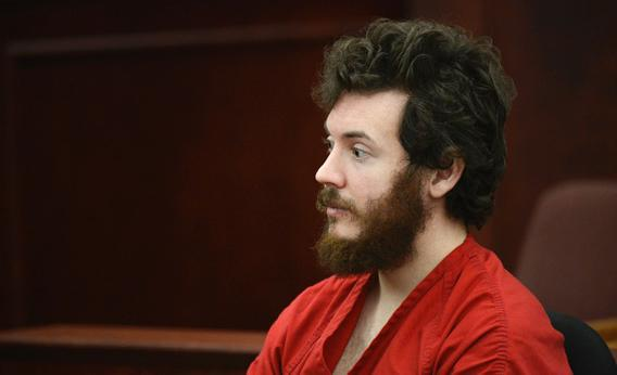 James Holmes, Aurora theater shooting suspect, sits in the courtroom during his arraignment in Centennial, Colo., on Tuesday, March 12, 2013.