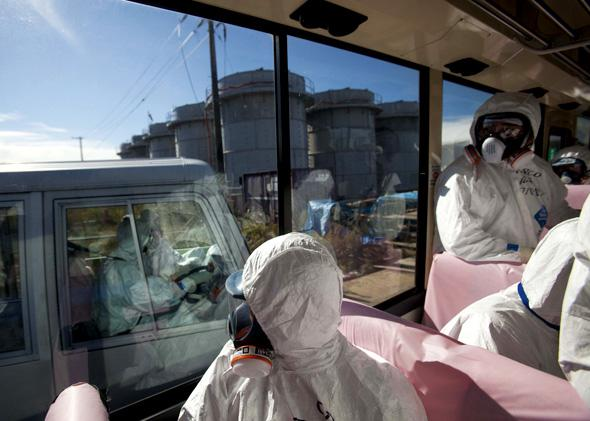 Buses tour the grounds of the Fukushima Daiichi nuclear power plant.