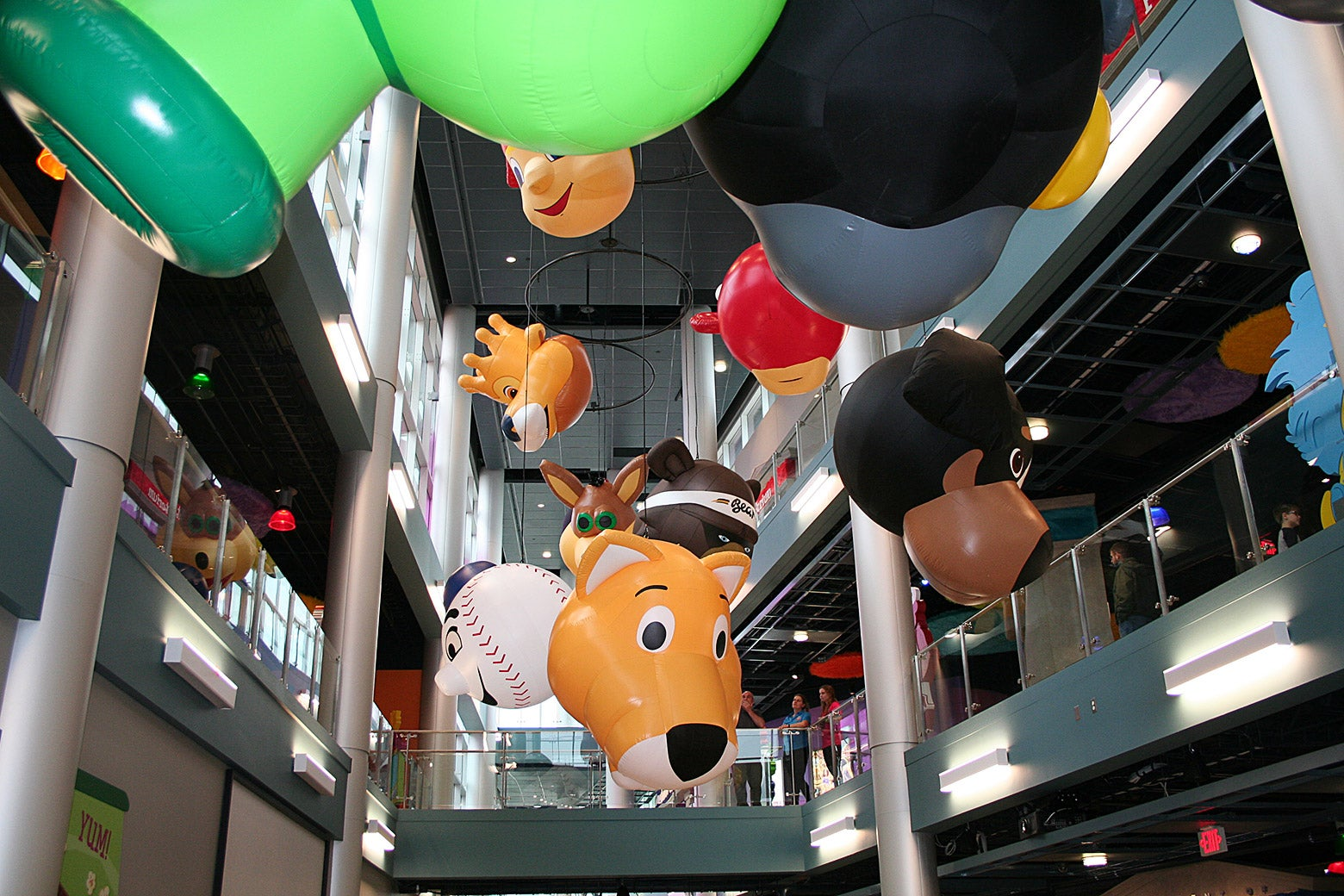 Mascot balloons hanging from the ceiling at the Mascot Hall of Fame.