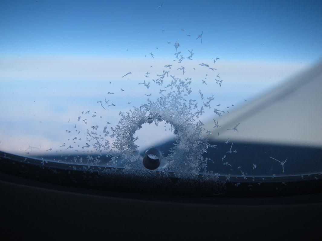 What's That Thing: Why are there holes in airplane windows?