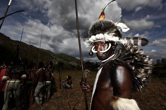 A Papuanese tribal man poses for a photograph during the Baliem Valley Festival on August 9, 2010 in Wamena, Indonesia.