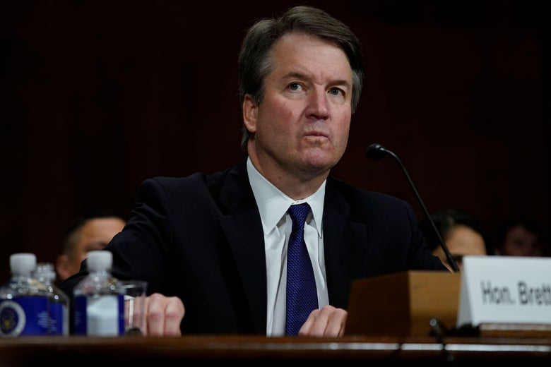 Supreme court nominee Brett Kavanaugh looks frustrated while sitting before the committee.