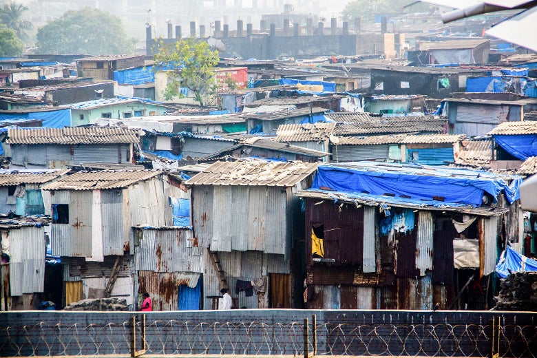 A view of huts and hanging clothes in a slum