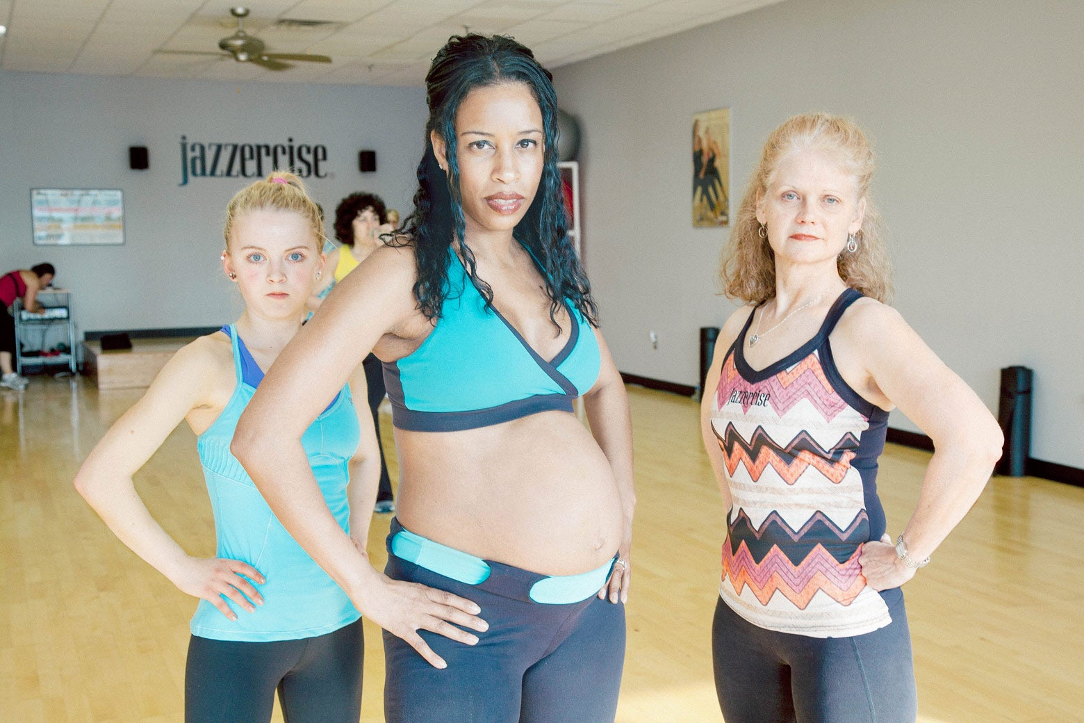 Alicia with two other women in a Jazzercise studio.