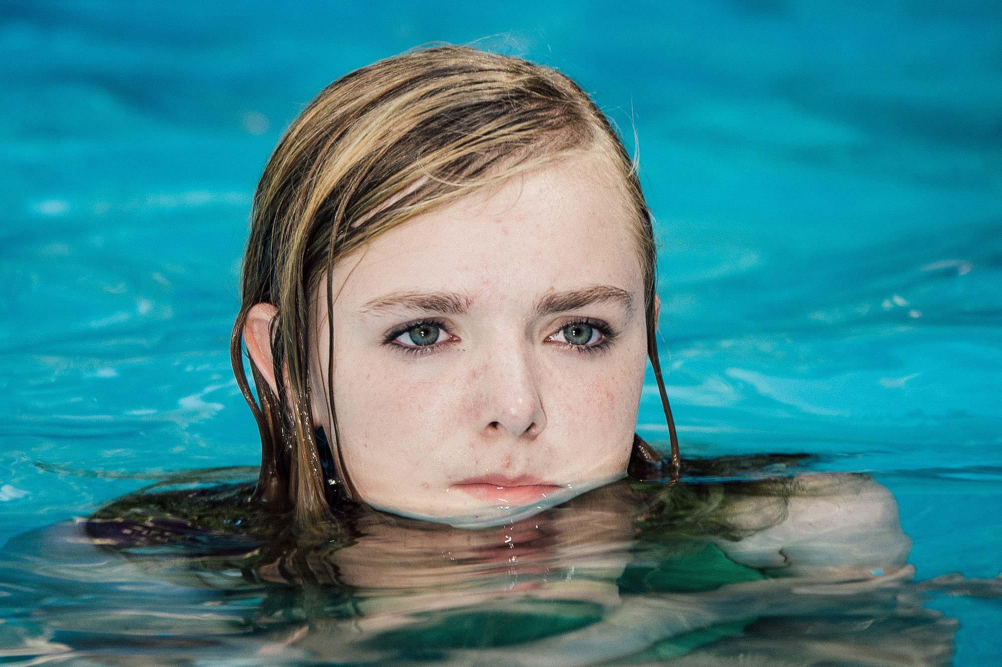 A teenage girl in a swimming pool.