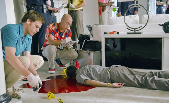 C.S. Lee as Vince Masuka and Michael C. Hall as Dexter Morgan in 'Dexter.'