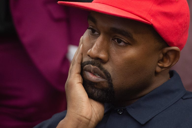 "Kanye West wears a red hat and puts his hand to his cheek. ""Srcset ="" https://compote.slate.com/images/5fb2ecdb-62d0-45f6-89b7-6fe31189f3ac.jpeg?width=780&height=520&rect=3000x2000&offset = 0x0 1x, https://compote.slate.com/images/5fb2ecdb-62d0-45f6-89b7-6fe31189f3ac.jpeg?width=780&height=520&rect=3000x2000&offset=0x0 2x"
