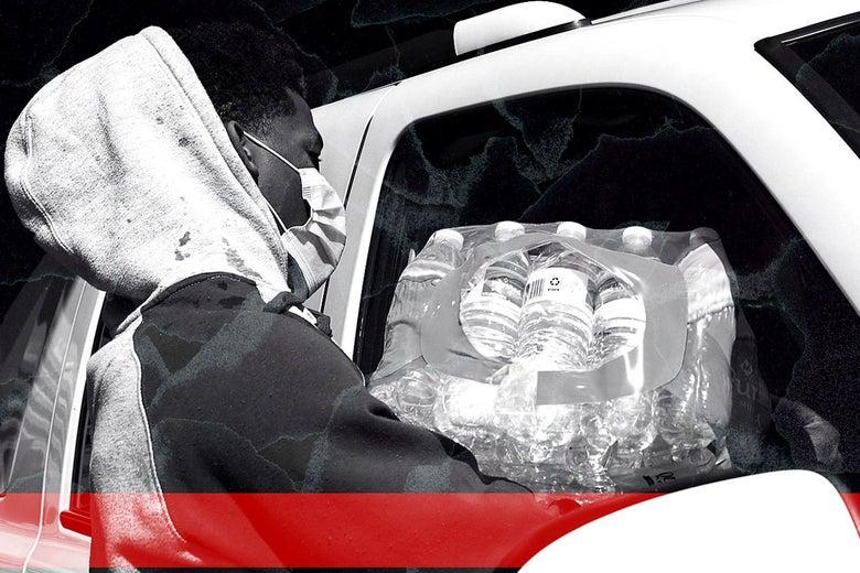 A man loads water bottles into a car.
