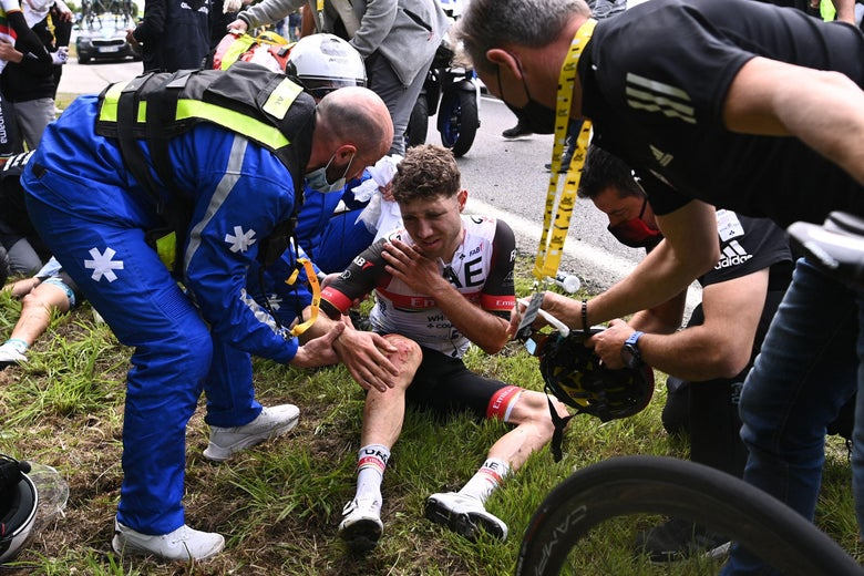 Team UAE Emirates' Marc Hirschi of Switzerland receives medical treatment after crashing during the 1st stage of the 108th edition of the Tour de France cycling race, 197 km between Brest and Landerneau, on June 26, 2021.