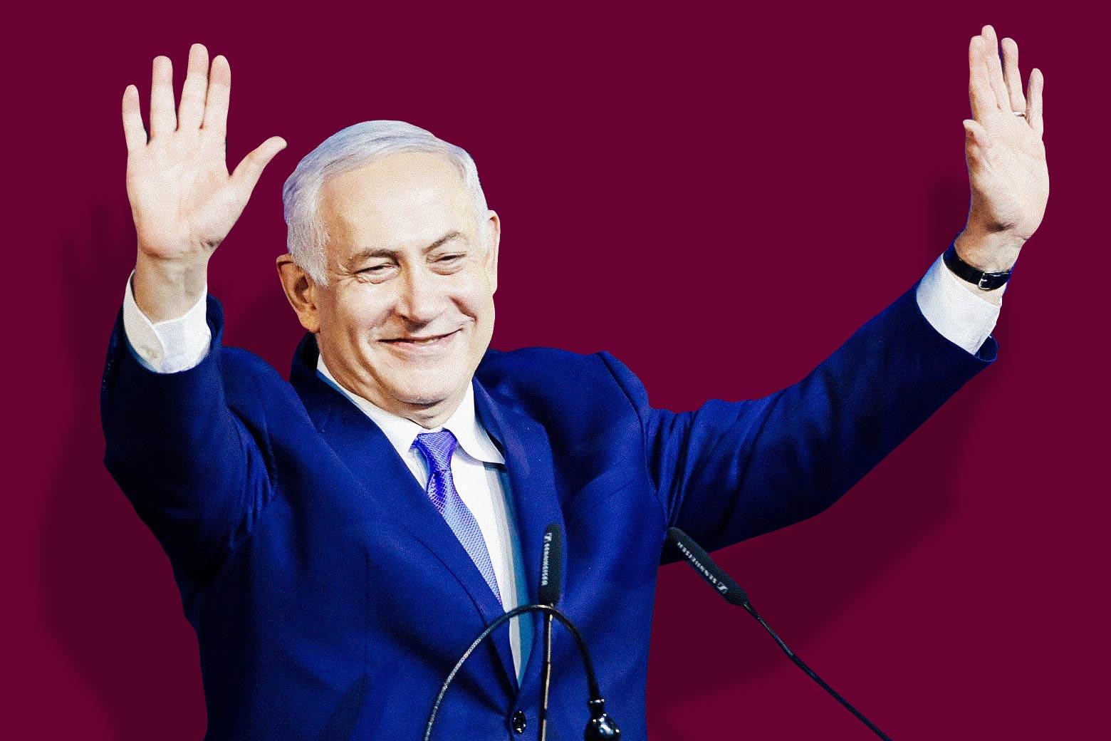 Israeli Prime Minister Benjamin Netanyahu with arms raised
