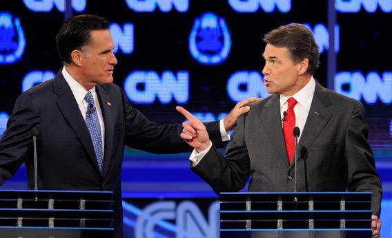 Former Massachusetts Gov. Mitt Romney and Texas Gov. Rick Perry at Tuesday's Republican presidential debate.