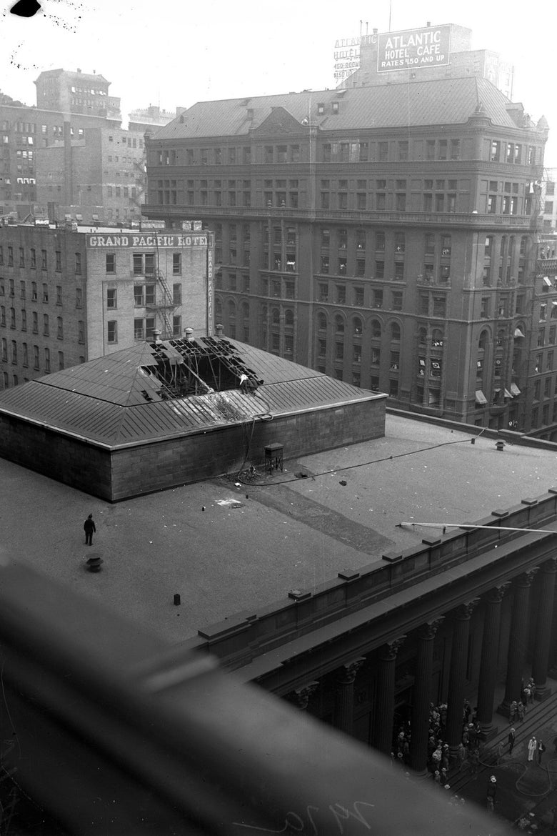 The roof of the bank after the crash, showing a blimp-sized hole in the skylight.