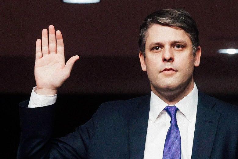 Justin Walker raises his hand